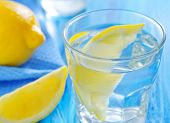 image of crystal glass  - water with lemons in glass and on a table - JPG