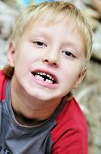 picture of tooth-fairy  - little boy showing that he lost first milk tooth - JPG
