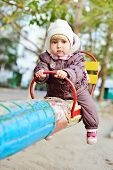 image of scared baby  - a little baby girl on the playground - JPG