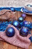 stock photo of ball cap  - Christmas decorations with balls woolen scarf and cap - JPG