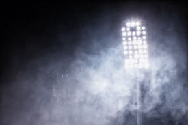 stock photo of light-pole  - lights in football stadium and a smoke flares - JPG