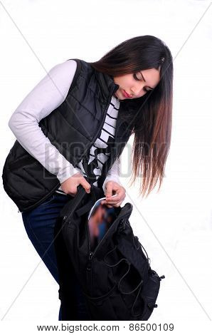 student girl looking for something backpack