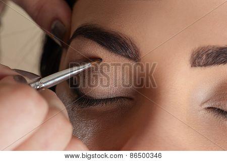 makeup artist working make-up brush