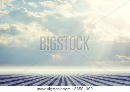 Abstract background is sky with clouds and stripes on concrete at bottom