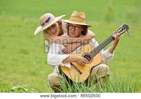 Hugging And Playing Guitar