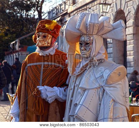 Masked Persons In Costume On Carnival In Venice, Italy.
