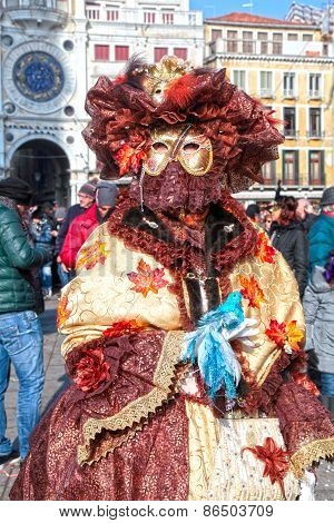 Masked Woman In Costume On San Marco Square, Venice, Italy.