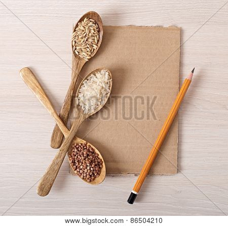 wooden spoons and buckwheat, rice and oats