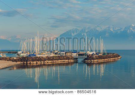 Small port with many boats on sunset, Lake Geneva, Switzerland