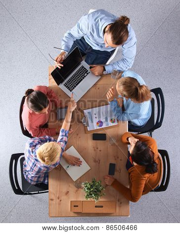 Business people sitting and discussing at business meeting, in office