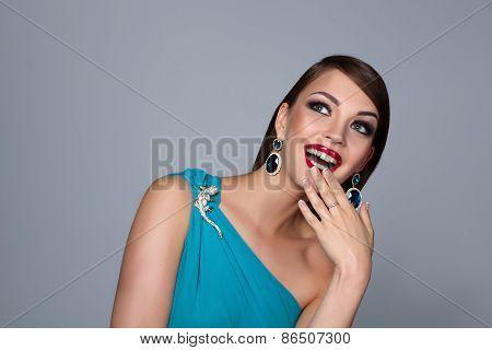 Portrait of beautiful brunette woman in blue dress