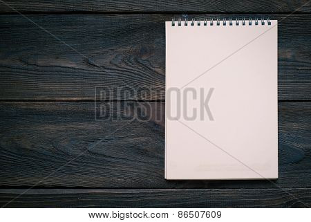 Notebook With Blank Sheet On A Wooden Surface