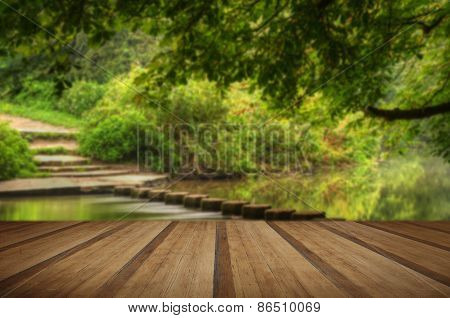 Beautiful Forest Scene Of Enchanted Stream Flowing Through Lush Green Foliage With Wooden Planks Flo