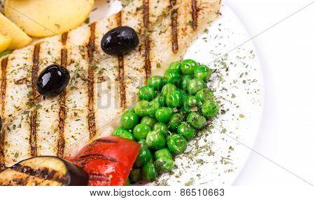 Grilled fish fillet with tasty vegetables.