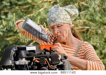 Woman Changing Engine Oil