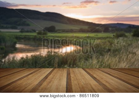 Summer Sunset Reflected In River In Countryside Landscape During Late Summer With Wooden Planks Floo