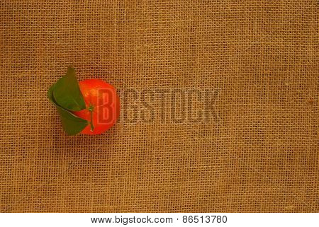 Clementine with Leaves on Hessian