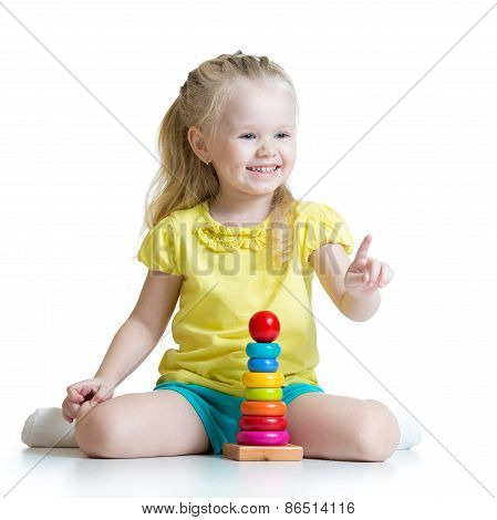 child girl playing with color pyramid toy