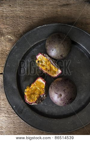 Passion Fruit In Moody Natural Light Setting With Vintage Retro Style