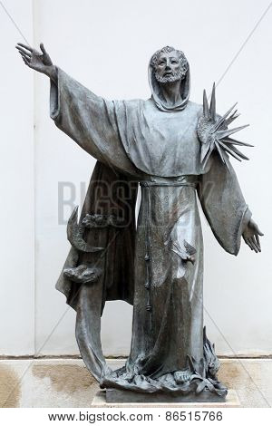 VIENNA, AUSTRIA - OCTOBER 10: Statue of Saint Francis of Assisi in Vienna, Austria on October 10, 2014. It was installed on the north side of Minoritenkirche church in 2003.