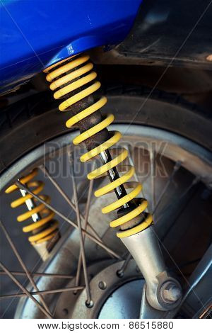 Shock Absorbers Of Yellow Motorcycles At The Park
