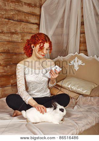 Redhead Girl Listening To Music On Headphones