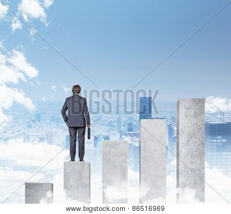 Businessman Standing On Chart