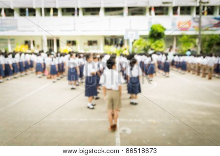 Blurred Schoolchild Standing In Row In School