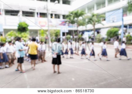 Blurred Schoolchild Walking In Row In School