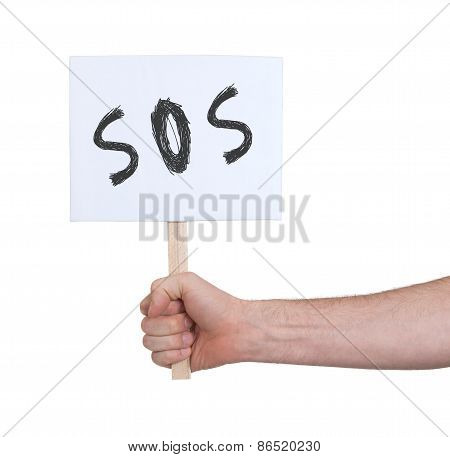 Hand Holding SOS Sign, Isolated On White