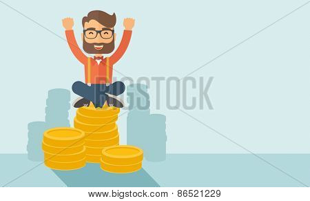 An overjoyed young hipster Caucasian man with beard sitting on the top of coins. Raising his two hands to show that he is a winner. Happy, winner concept. A contemporary style with pastel palette