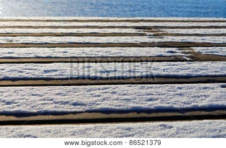Bridge Made Of Plank With Snow And Ocean