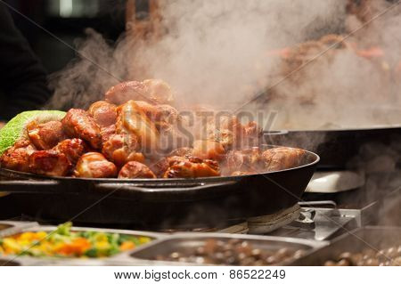Meat Is Fried On A Big Frying Pan At Street Fair