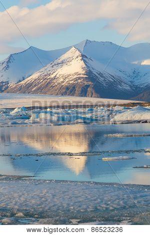 Snow mountain reflection in Jokulsarlon lagoon