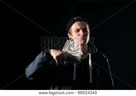 Young Man With Money In His Hands