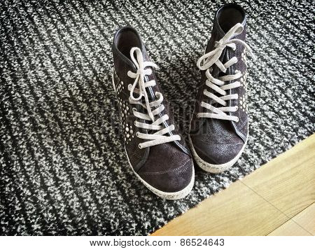 Fashionable Shoes On Gray Striped Carpet