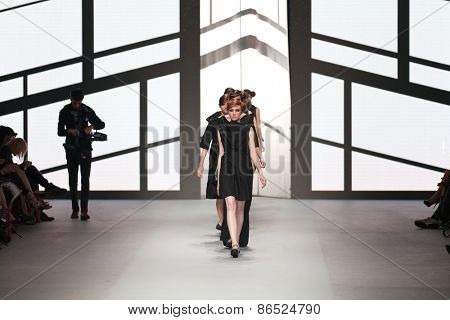 ZAGREB, CROATIA - MARCH 21, 2015: Fashion models wearing clothes designed by Morana Krklec on the 'Fashion.hr' fashion show