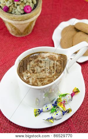 Cup Of Coffee With Bombons And Biscuits