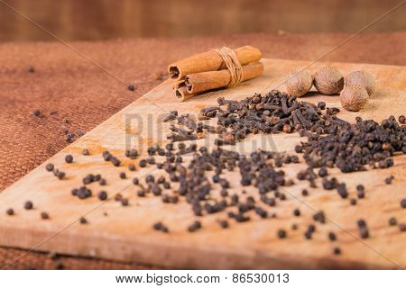 Black pepper. Pepper scattered on the table