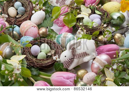 Assorted Eggs And Flowers For Easter On White