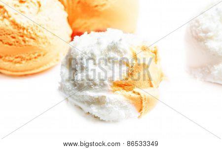 Vanilla And Orange Ice Cream Balls Macro. Beautiful Scoops Of Ice-cream Close