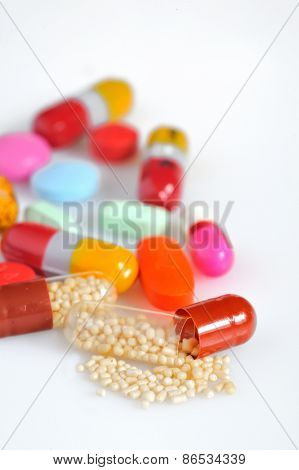 Many colorful pills isolated on white