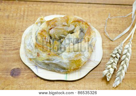 Savory Meat  Pie With Seeds On A Wooden Table