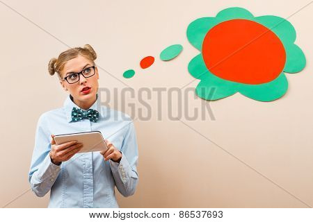 Geek girl using digital tablet