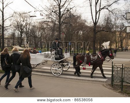 Krakow, Poland - March 29, 2015: Horse Carriage On The Streets Of The City