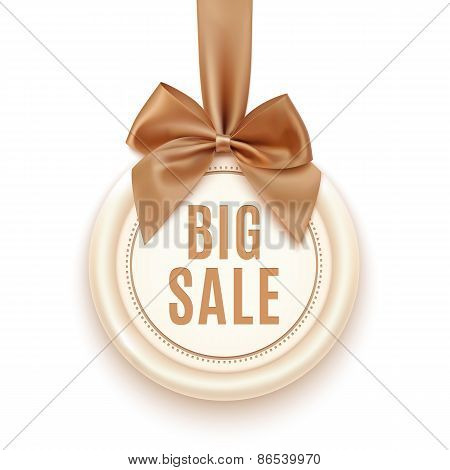 Big sale badge with golden ribbon and bow.
