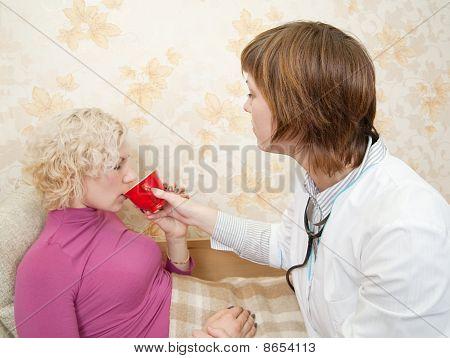 Nurse  Gives A Cup To Sick Girl