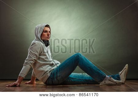 Hooded Man With Headphones On Neck