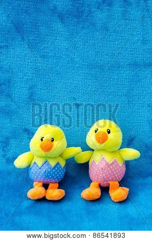 Pair Of Soft Toy Easter Baby Chicks On Blue Background