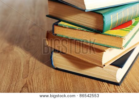Old books on wooden table, closeup